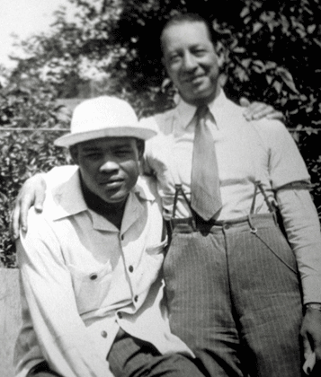 J.C. (right) with boxer Joe Louis