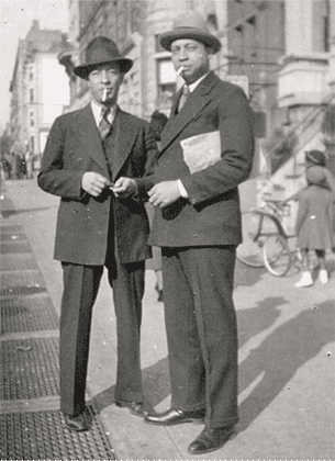 J.C. (left) on the street, 1930s